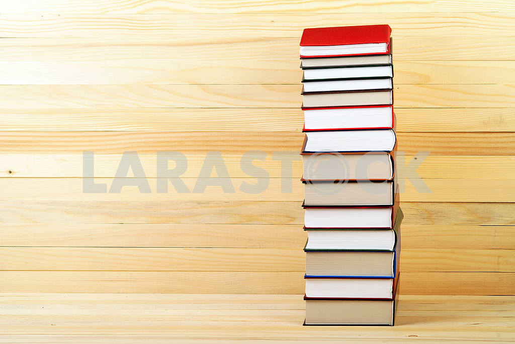 Stack of hardback books on blue cloth. Back to school. Copy space — Image 45353
