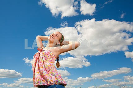 portrait of smiling girl in blue sky
