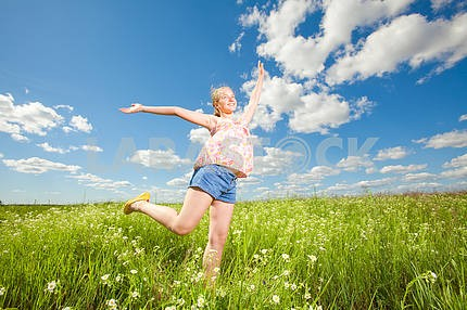 Pretty girl having fun flying in blue sky