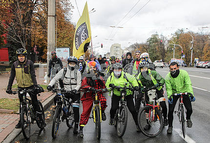 People on bikes in masks