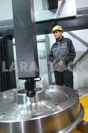 Worker near the drilling machine