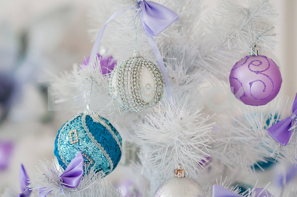 closeup of christmas tree decorations silver background blue toy on a white christmas tree with white and violet toys one style decorated - White Christmas Tree With Blue And Silver Decorations