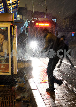 Passers by in the rain