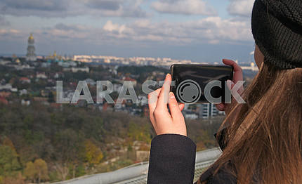 A man takes pictures of the Kiev-Pechersk Lavra,