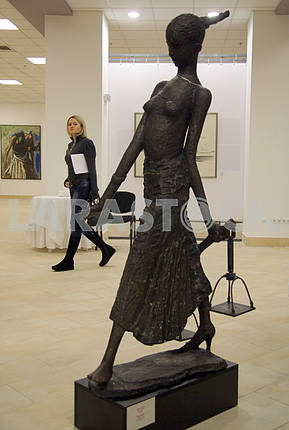 Girl and sculpture