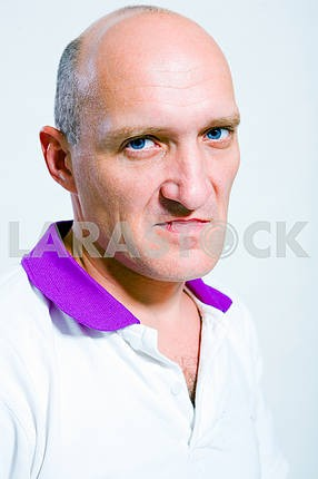 Portrait of the man indignation. Blue eyes. Bald