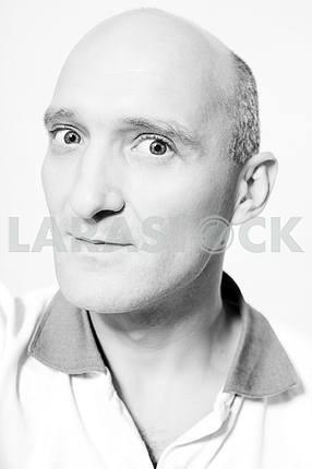 Portrait bald men smiles.