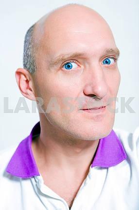 Portrait bald men smiles. Blue eyes