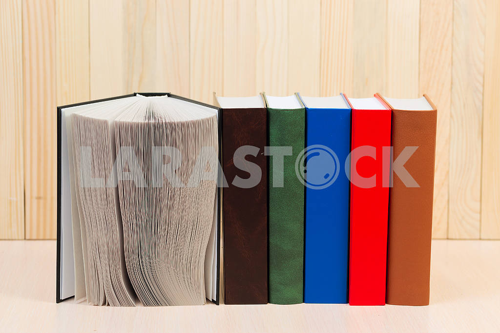 Stack of hardback books on wooden table. Back to school. — Image 46666