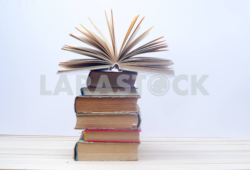 Stack of hardback books on wooden table. Back to school. — Image 46670