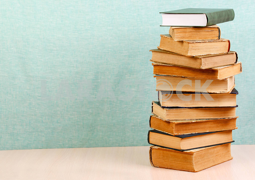 Stack of hardback books on wooden table. Back to school. — Image 46820