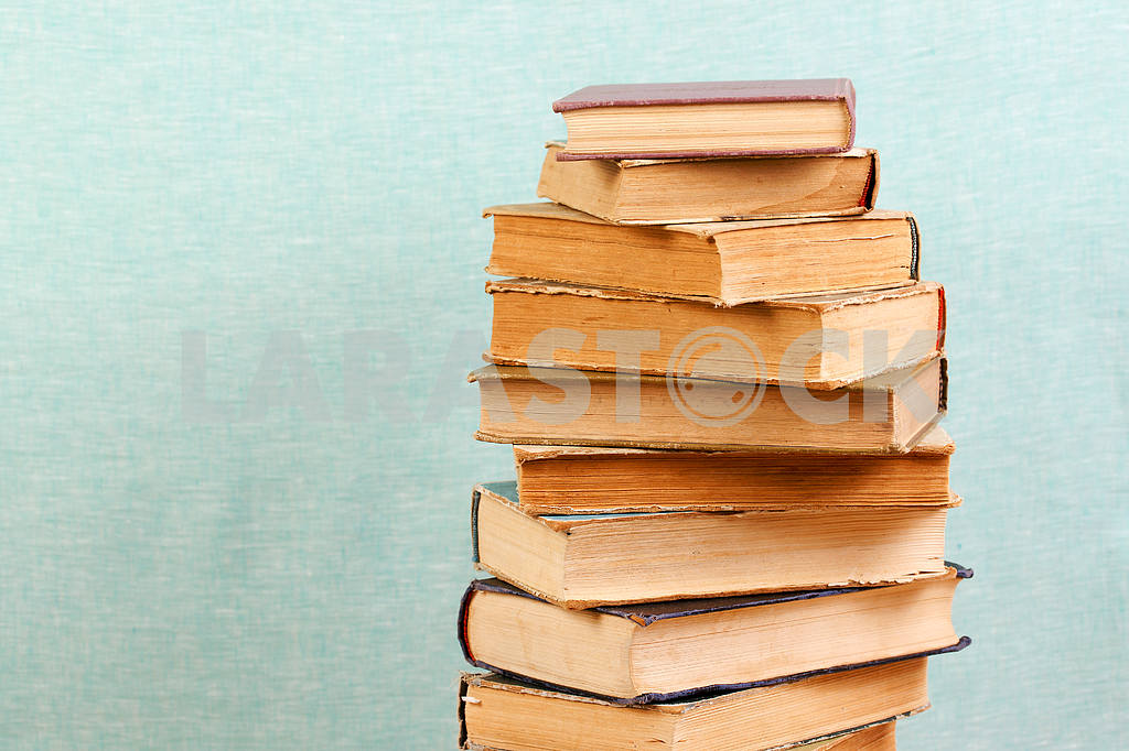 Stack of hardback books on wooden table. Back to school. — Image 46824