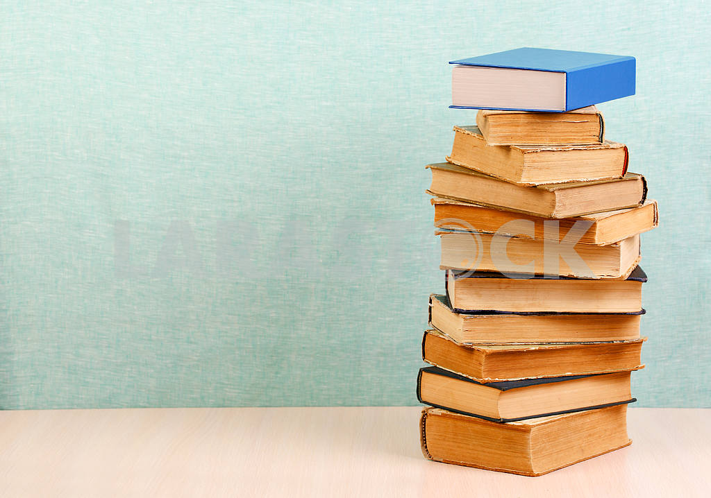 Stack of hardback books on wooden table. Back to school. — Image 46827