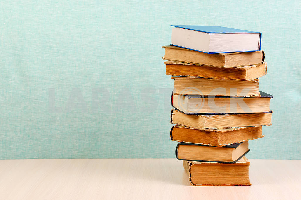 Stack of hardback books on wooden table. Back to school. — Image 46830