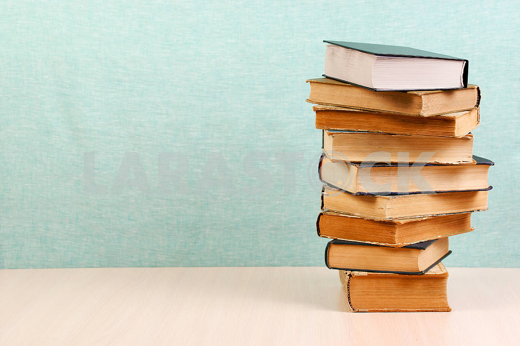 Stack of hardback books on wooden table. Back to school. — Image 46834