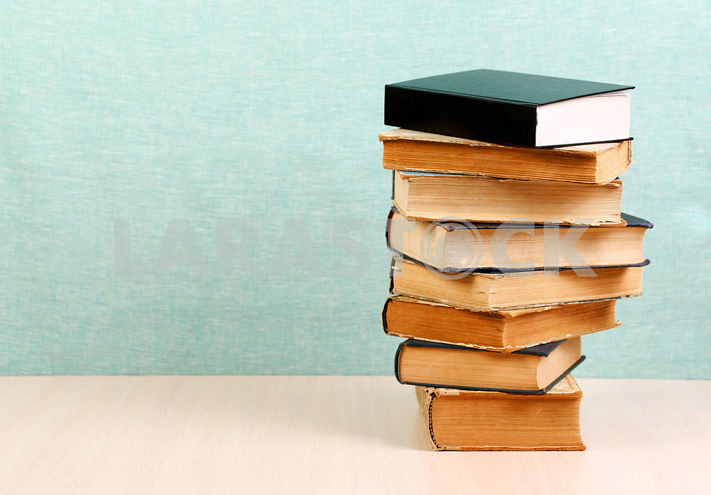 Stack of hardback books on wooden table. Back to school. — Image 46835