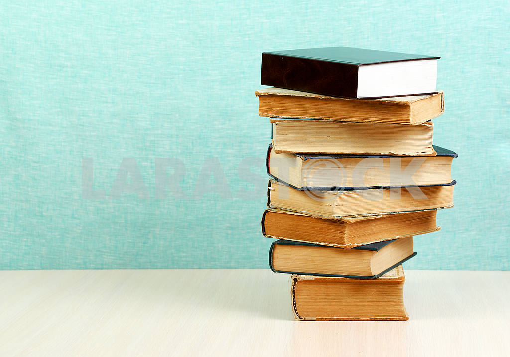 Stack of hardback books on wooden table. Back to school. — Image 46838