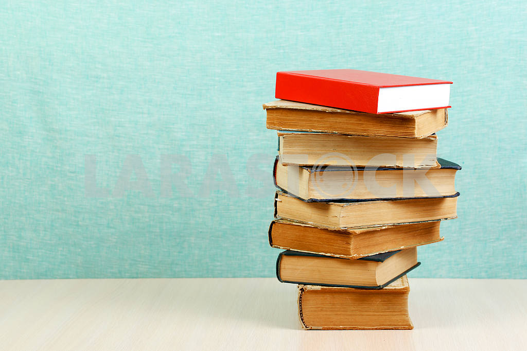 Stack of hardback books on wooden table. Back to school. — Image 46839