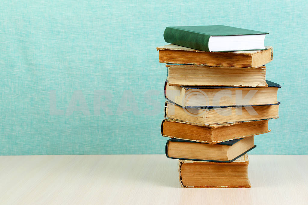 Stack of hardback books on wooden table. Back to school. — Image 46841