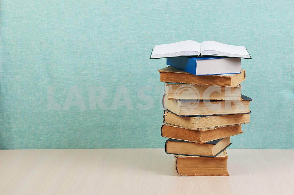 Stack of hardback books on wooden table. Back to school. — Image 46846