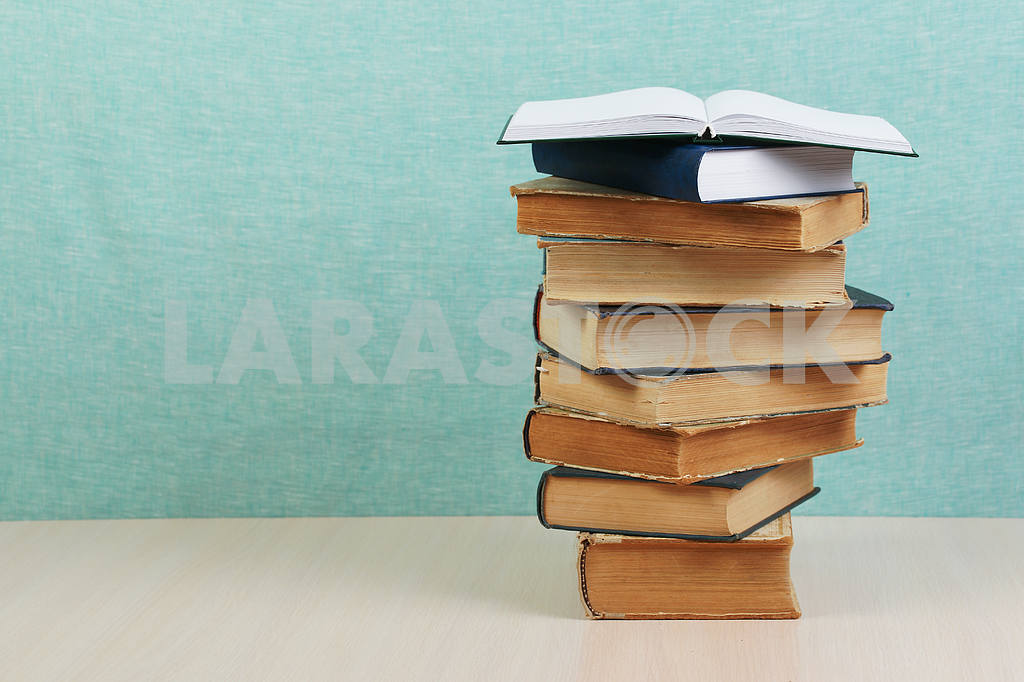 Stack of hardback books on wooden table. Back to school. — Image 46848