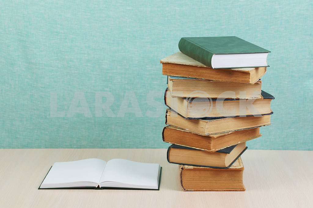 Stack of hardback books on wooden table. Back to school. — Image 46850
