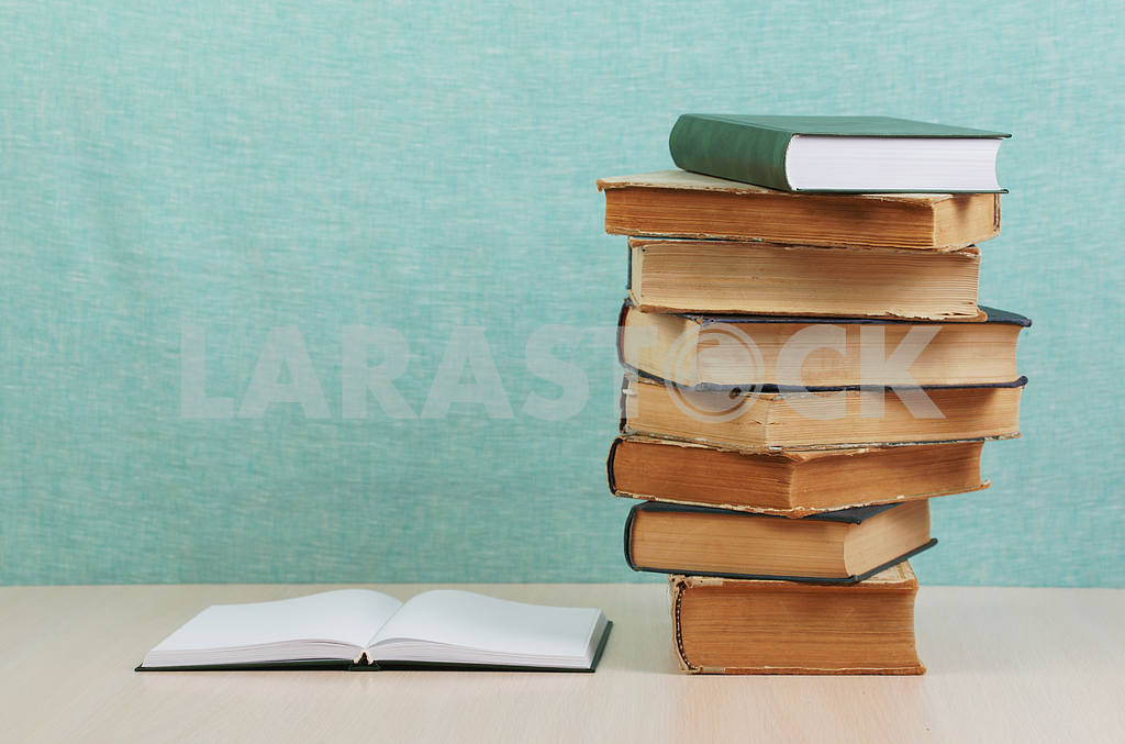 Stack of hardback books on wooden table. Back to school. — Image 46851
