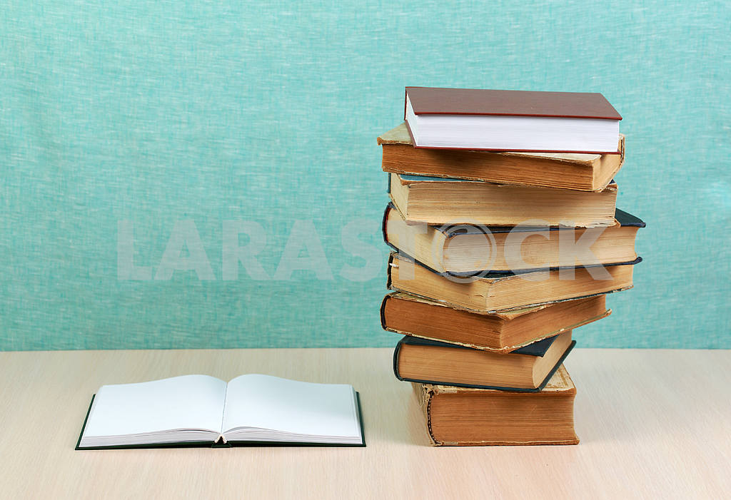 Stack of hardback books on wooden table. Back to school. — Image 46857