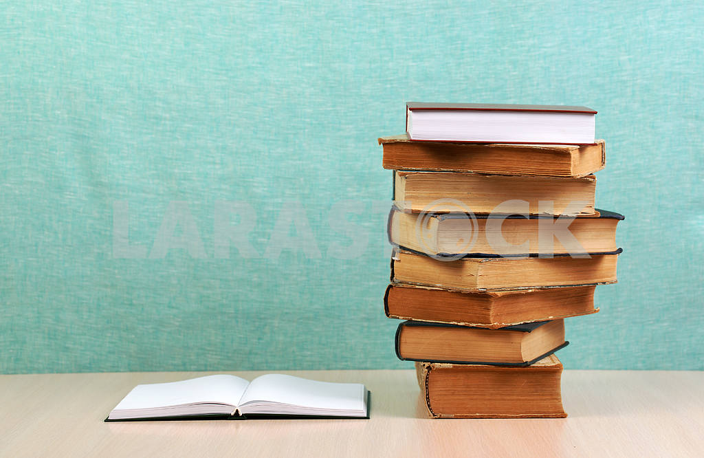 Stack of hardback books on wooden table. Back to school. — Image 46858