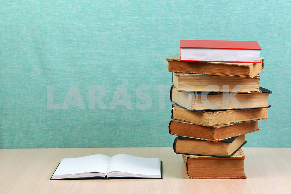 Stack of hardback books on wooden table. Back to school. — Image 46859