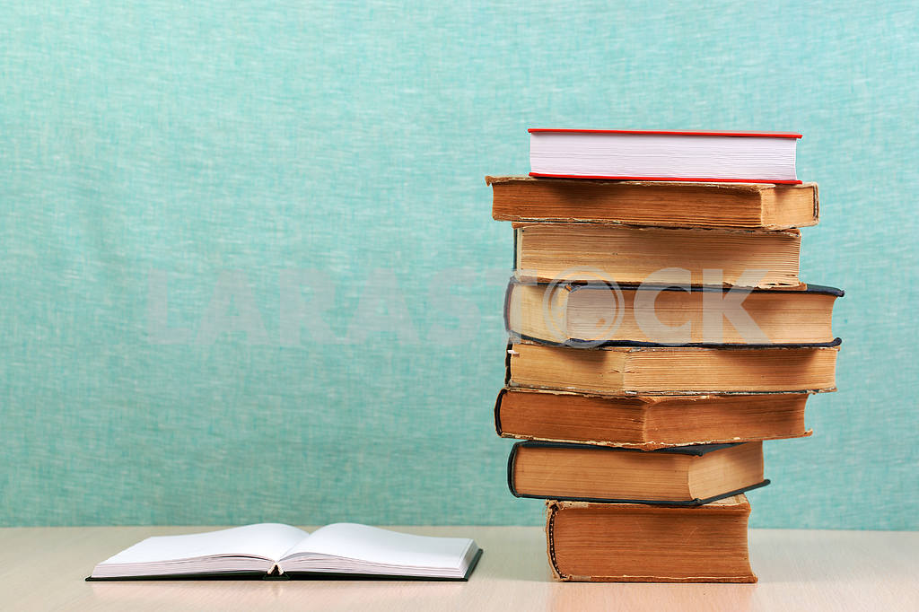 Stack of hardback books on wooden table. Back to school. — Image 46861