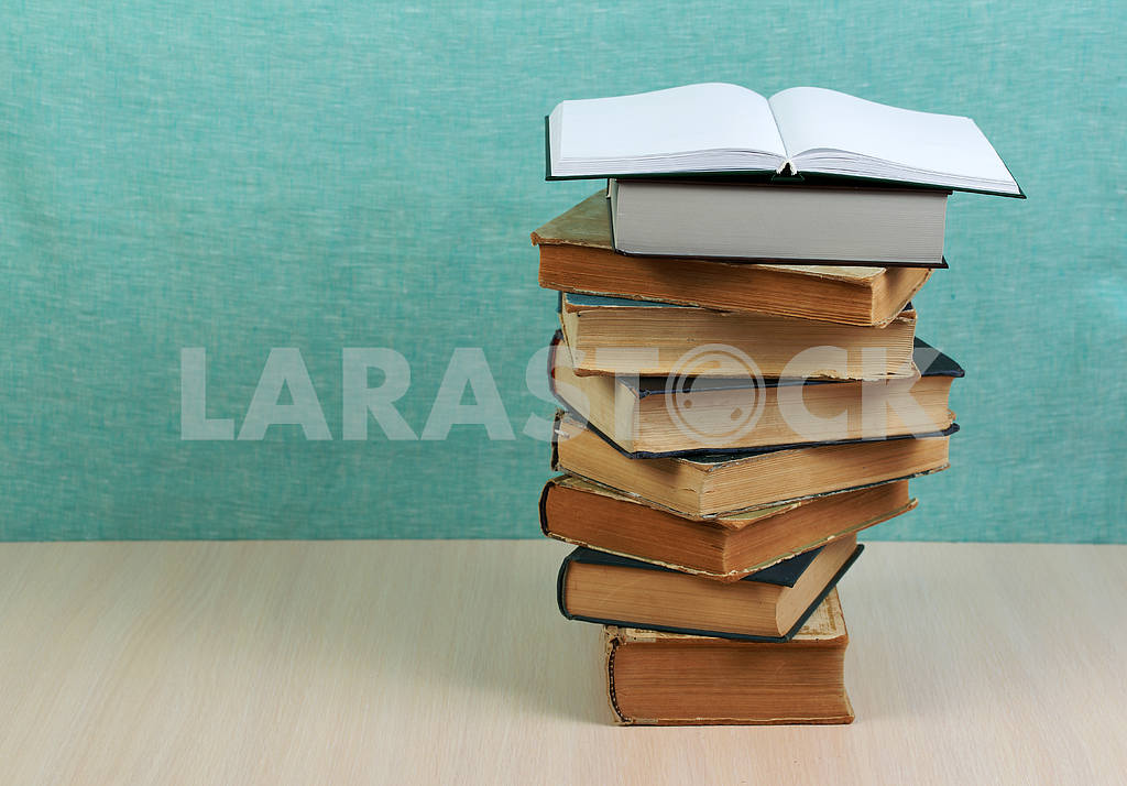 Stack of hardback books on wooden table. Back to school. — Image 46866