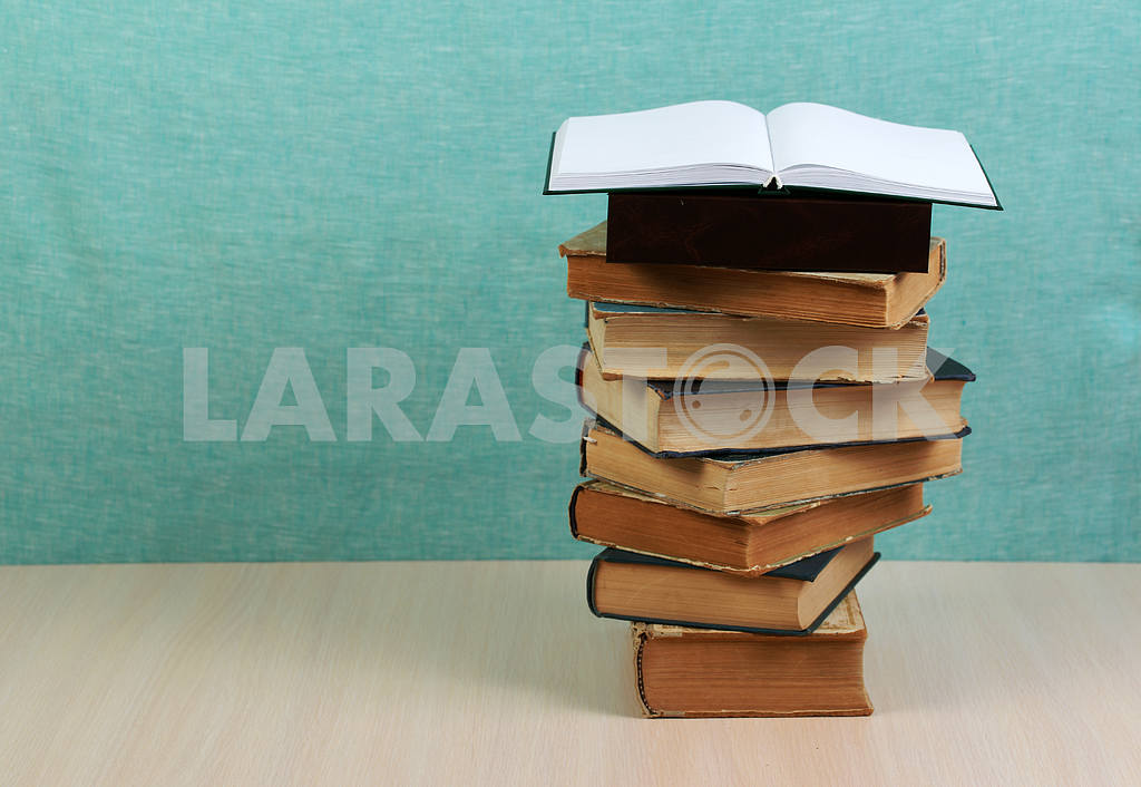 Stack of hardback books on wooden table. Back to school. — Image 46867