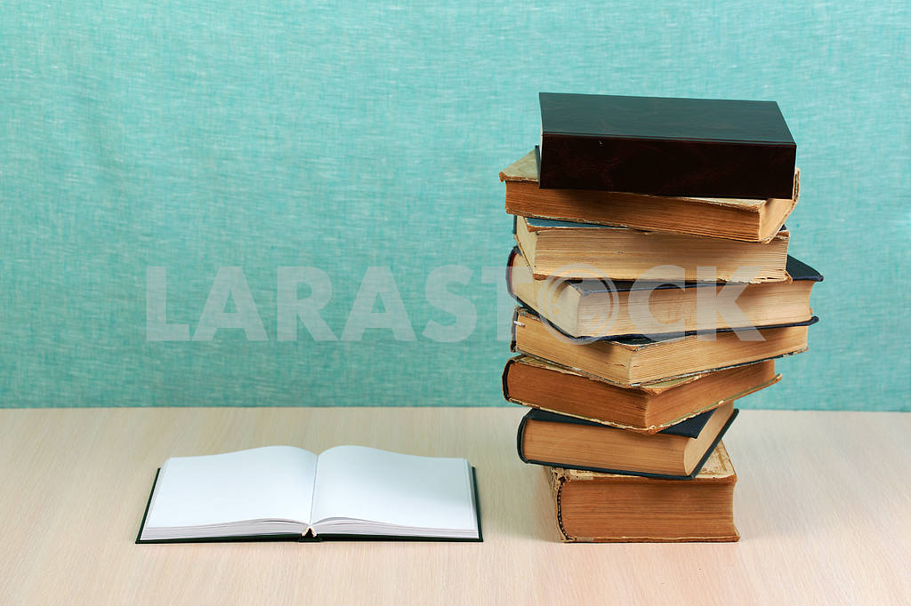 Stack of hardback books on wooden table. Back to school. — Image 46869