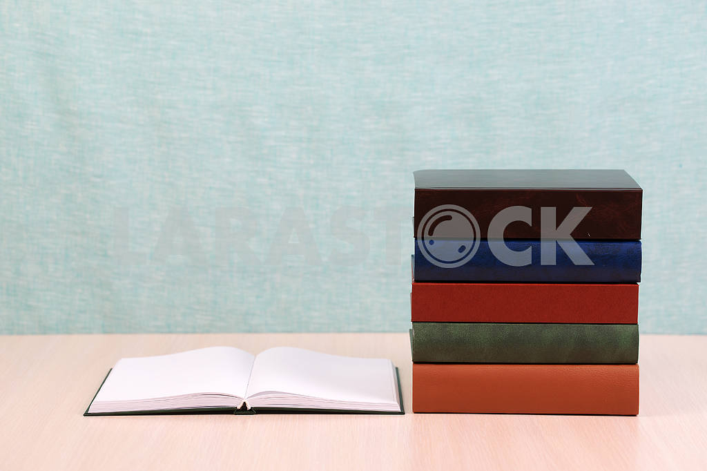 Stack of hardback books on wooden table. Back to school. — Image 46875
