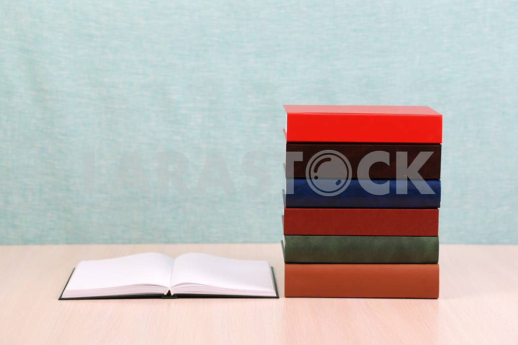Stack of hardback books on wooden table. Back to school. — Image 46876