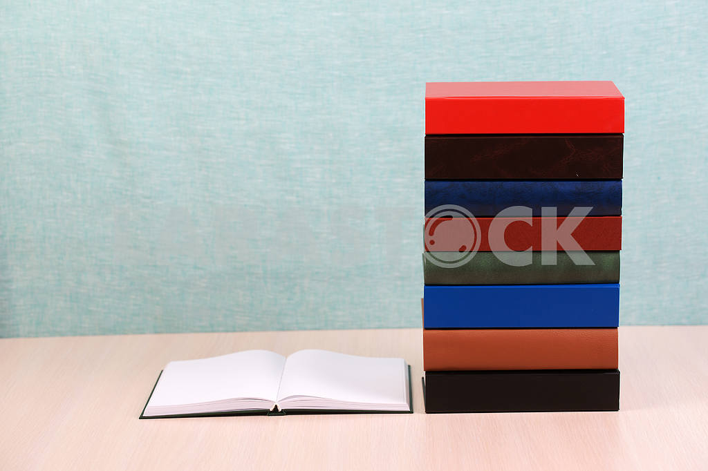 Stack of hardback books on wooden table. Back to school. — Image 46879