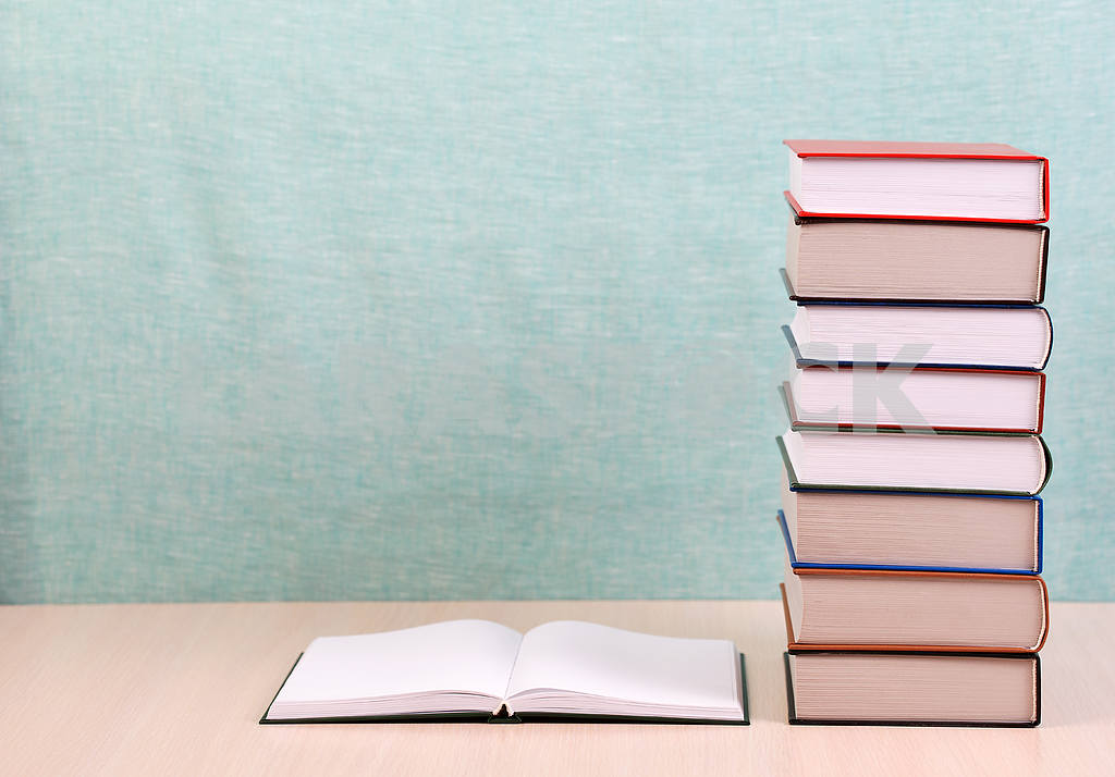 Stack of hardback books on wooden table. Back to school. — Image 46881