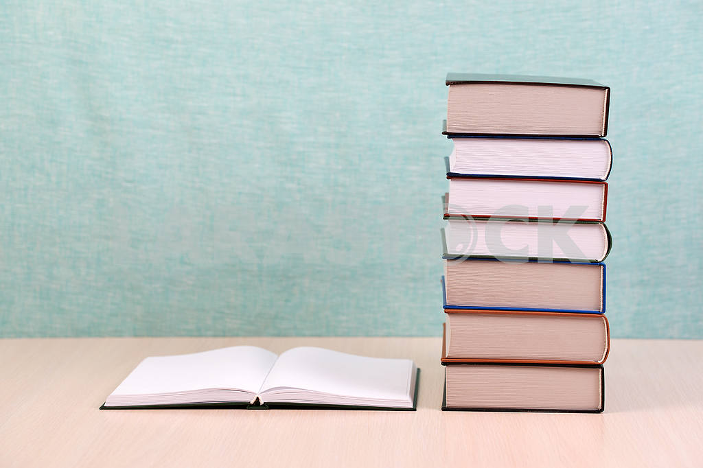 Stack of hardback books on wooden table. Back to school. — Image 46883