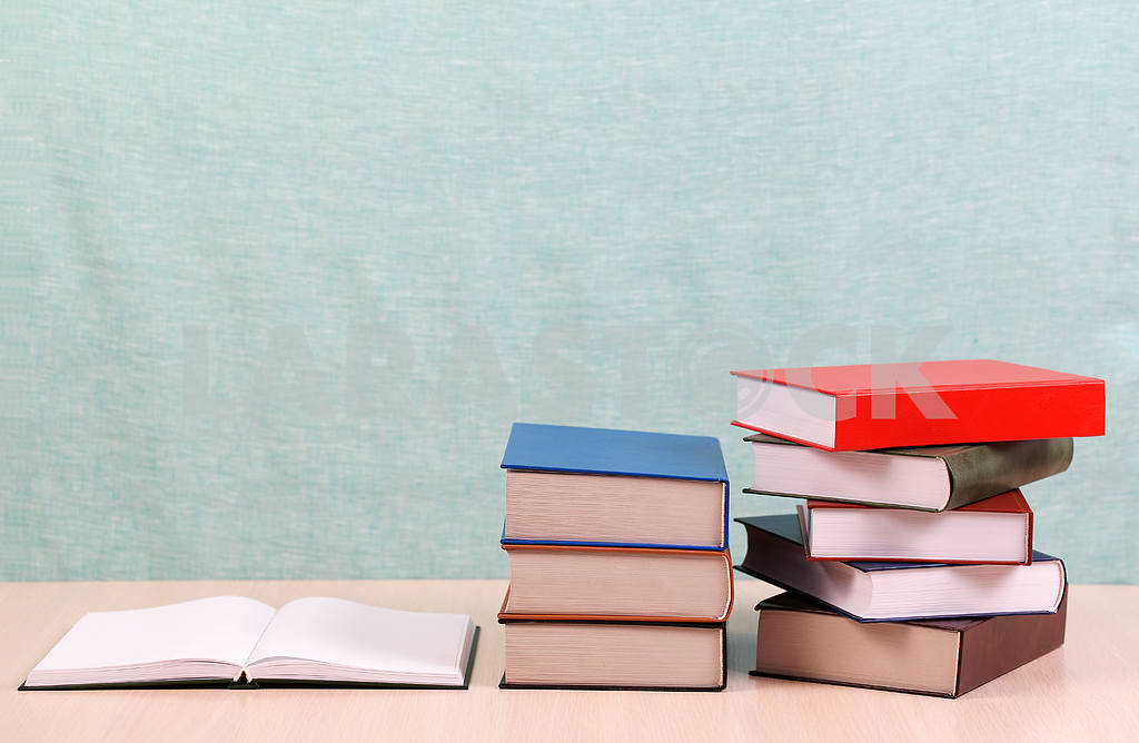 Stack of hardback books on wooden table. Back to school. — Image 46895