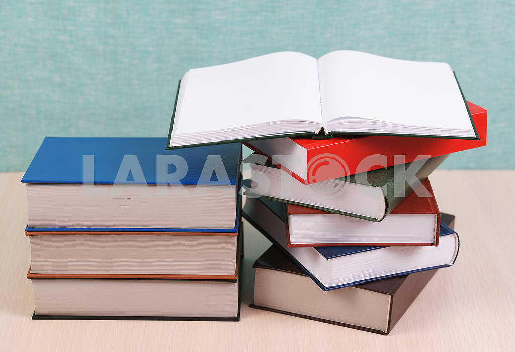 Stack of hardback books on wooden table. Back to school. — Image 46899