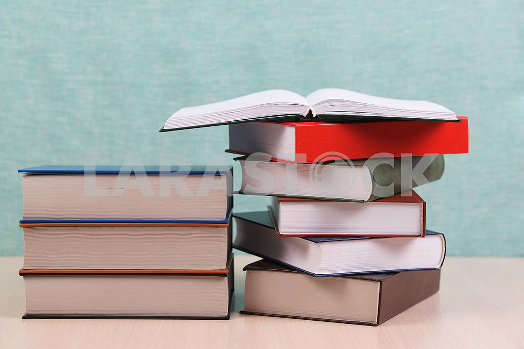 Stack of hardback books on wooden table. Back to school. — Image 46900