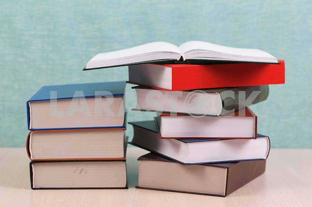 Stack of hardback books on wooden table. Back to school. — Image 46901
