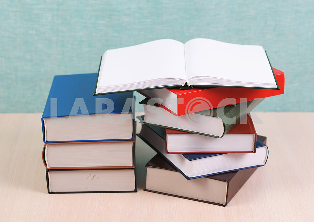 Stack of hardback books on wooden table. Back to school. — Image 46902