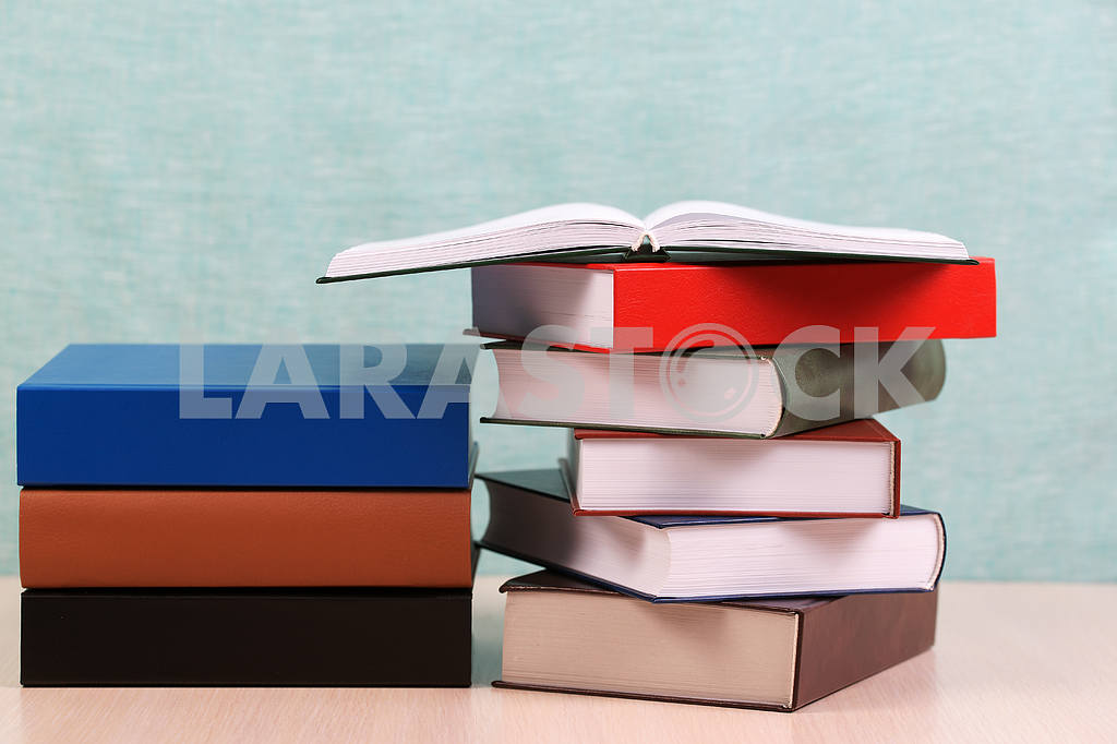Stack of hardback books on wooden table. Back to school. — Image 46904