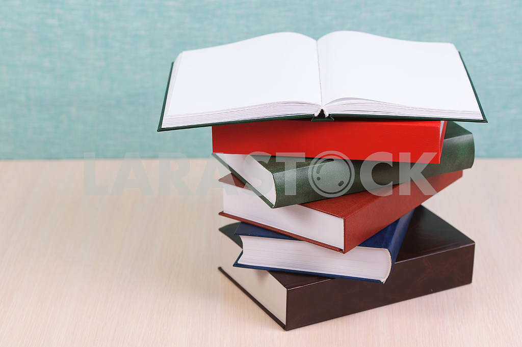 Stack of hardback books on wooden table. Back to school. — Image 46908