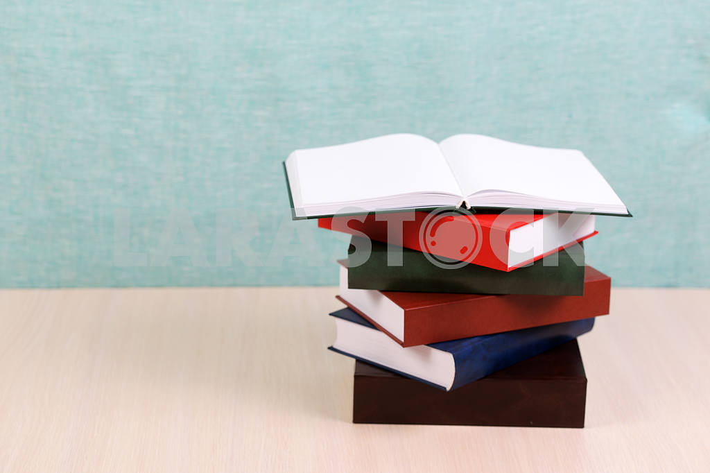 Stack of hardback books on wooden table. Back to school. — Image 46910