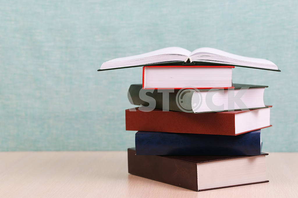 Stack of hardback books on wooden table. Back to school. — Image 46912
