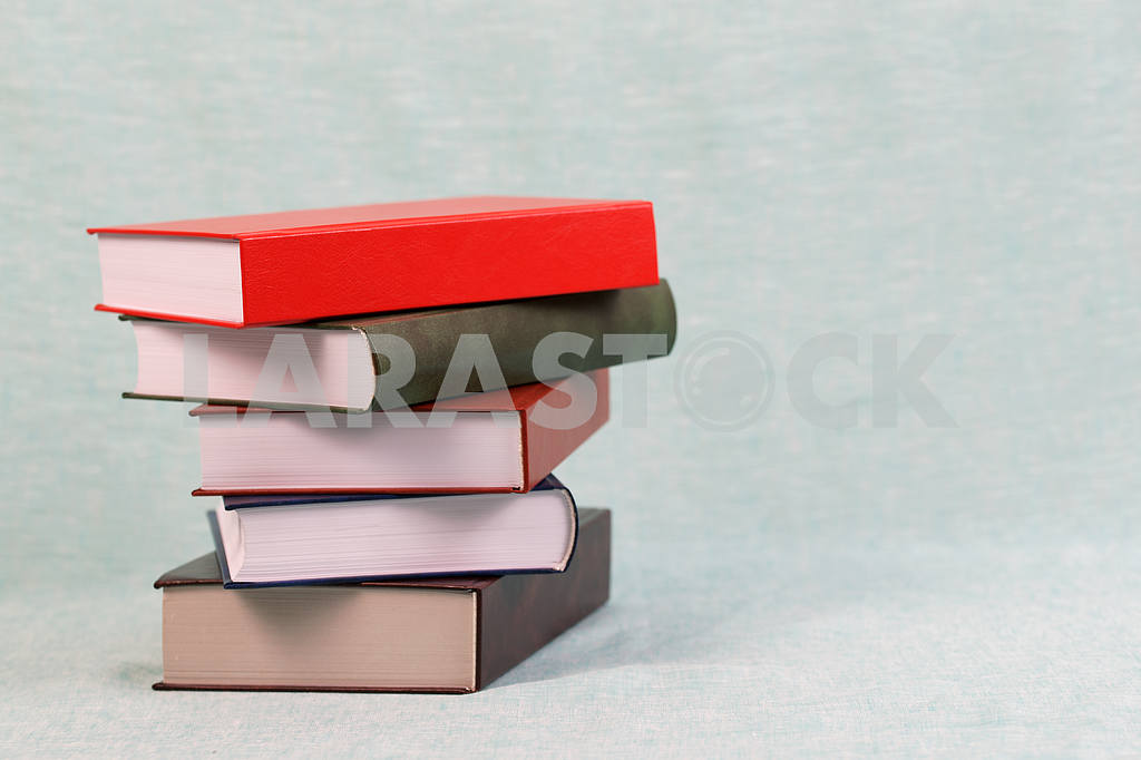 Stack of hardback books on wooden table. Back to school. — Image 46917