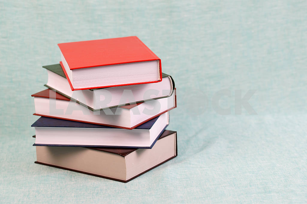 Stack of hardback books on wooden table. Back to school. — Image 46920